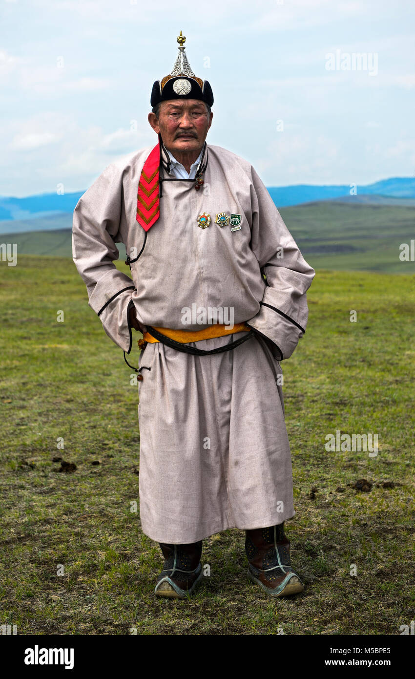 Elderly male nomad in traditional dress in the steppe, Mongolia - Stock Image