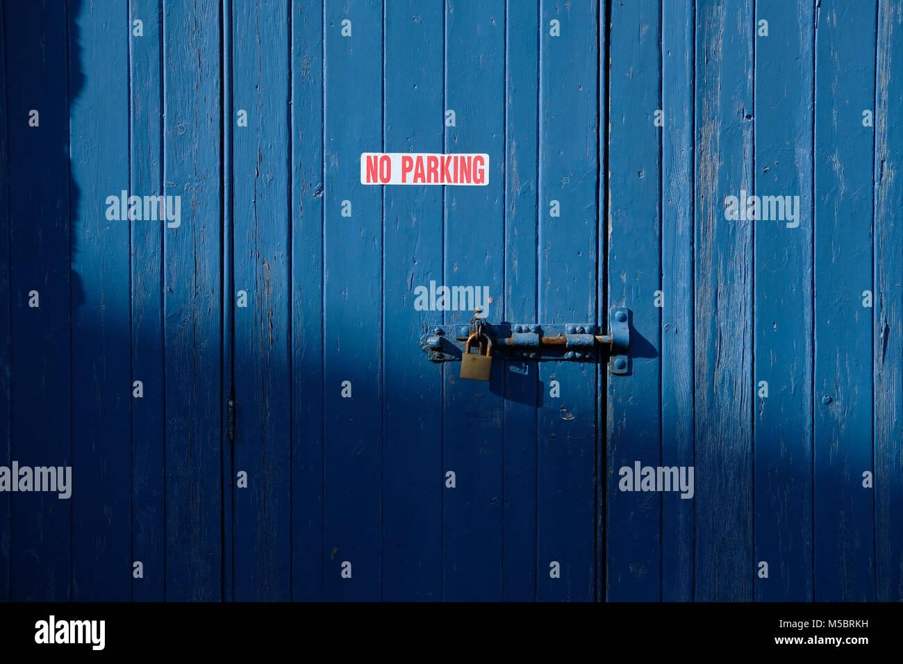 No parking sign on wooden door. Stock Photo