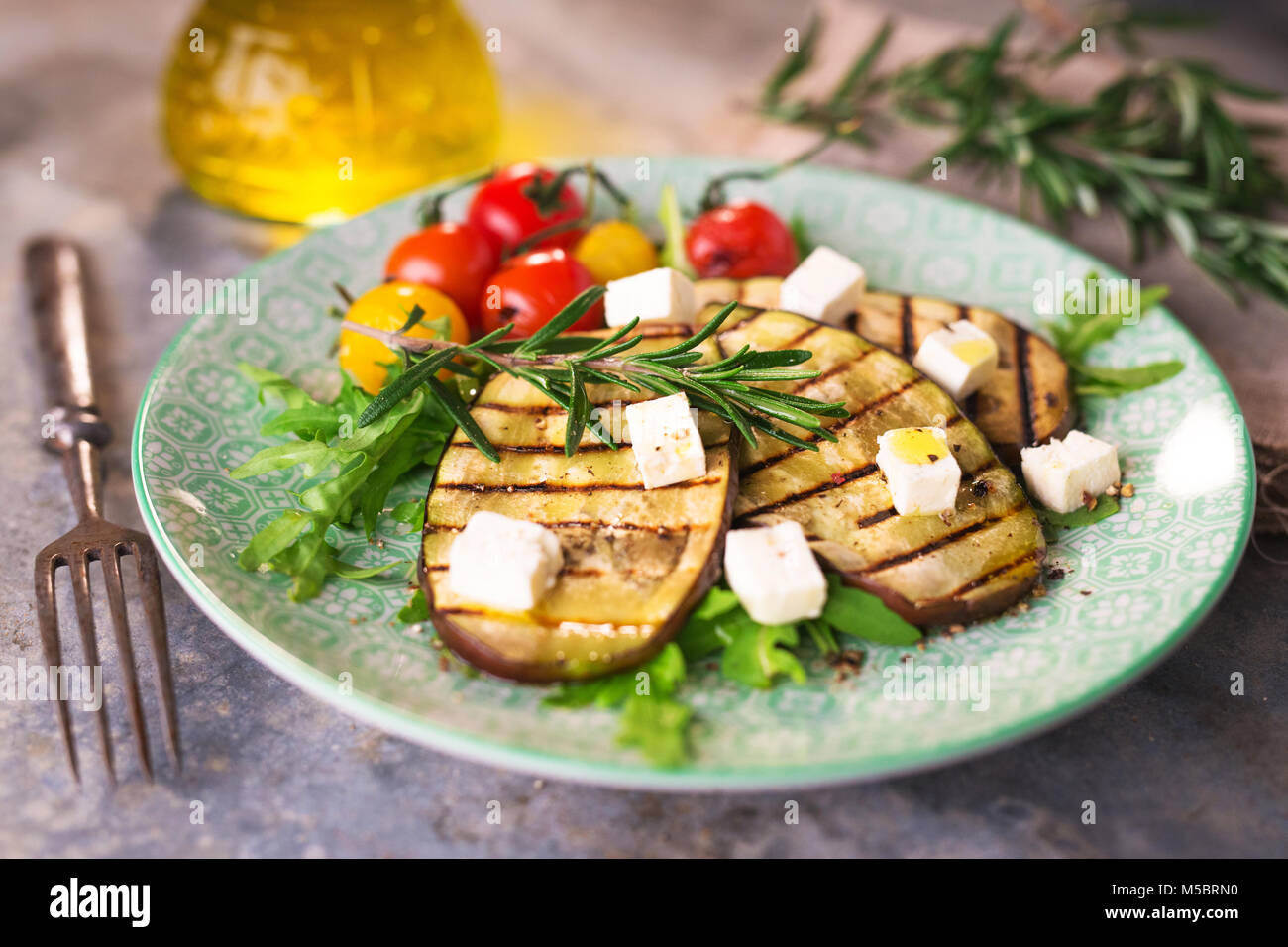 Griled eggplant with feta chese - Stock Image
