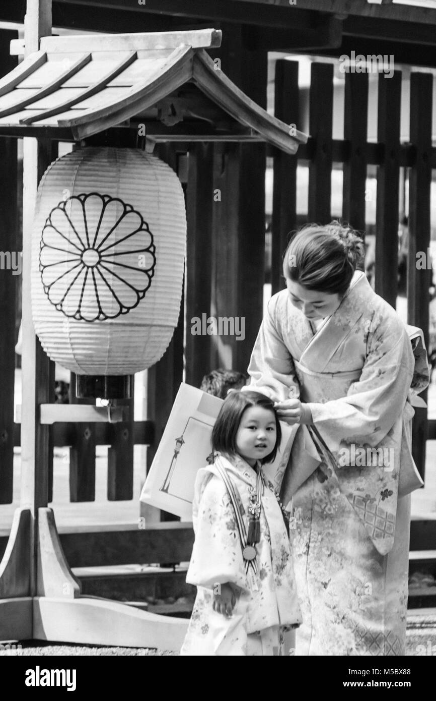 a woman and her daughter at the Autumn Grand Festival at Meiji Jingu Shrine, Tokyo - Stock Image
