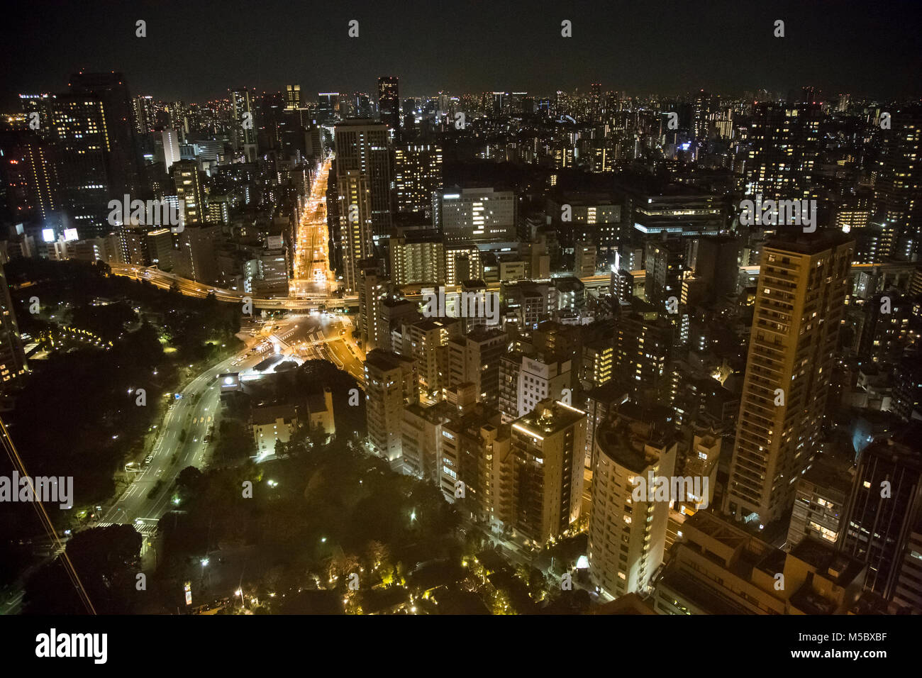 Views of the Tokyo cityscape and skyline at night, from atop Tokyo Tower in Tokyo. - Stock Image