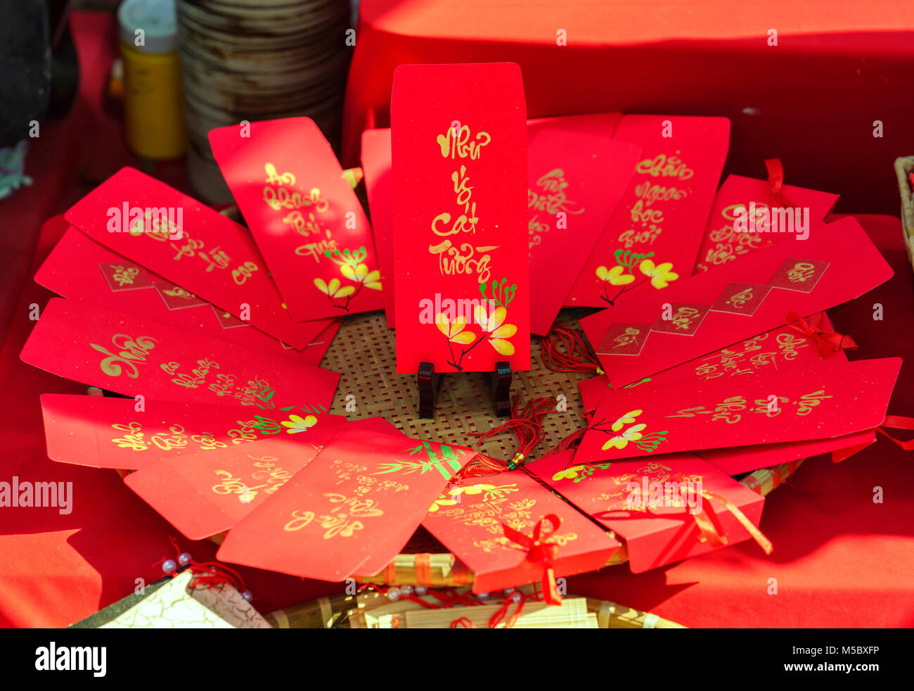 Red envelopes Lunar New Year Calligraphy decorated with text 'Merit, fortune, longevity' in Vietnamese means - Stock Image