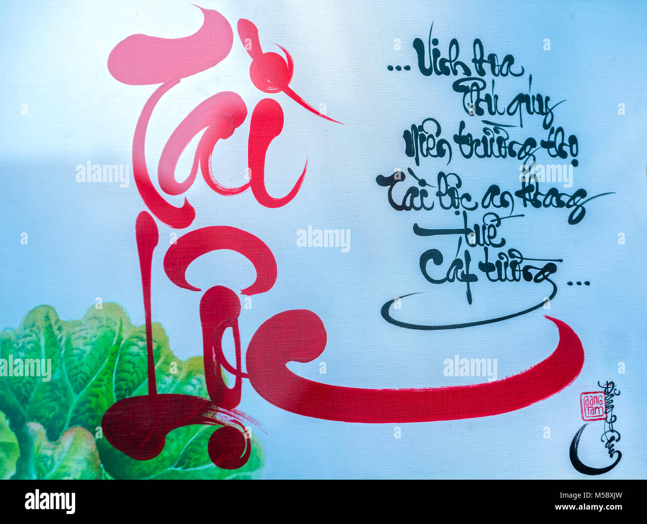 Lunar New Year Calligraphy decorated with text 'Merit, fortune, longevity' in Vietnamese meaning who owns - Stock Image