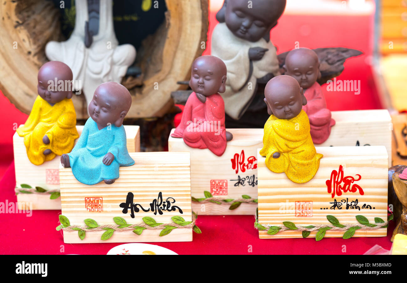 Decorative products decorated with text 'Peace' in Vietnamese meaning Although life has scarce, but we still - Stock Image