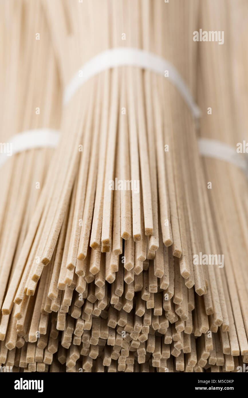 Japanese raw soba noodles bundles close up - Stock Image