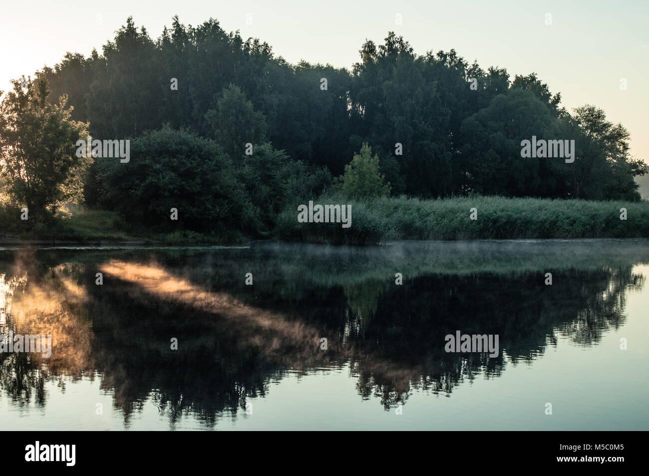 Lake in foggy morning. - Stock Image