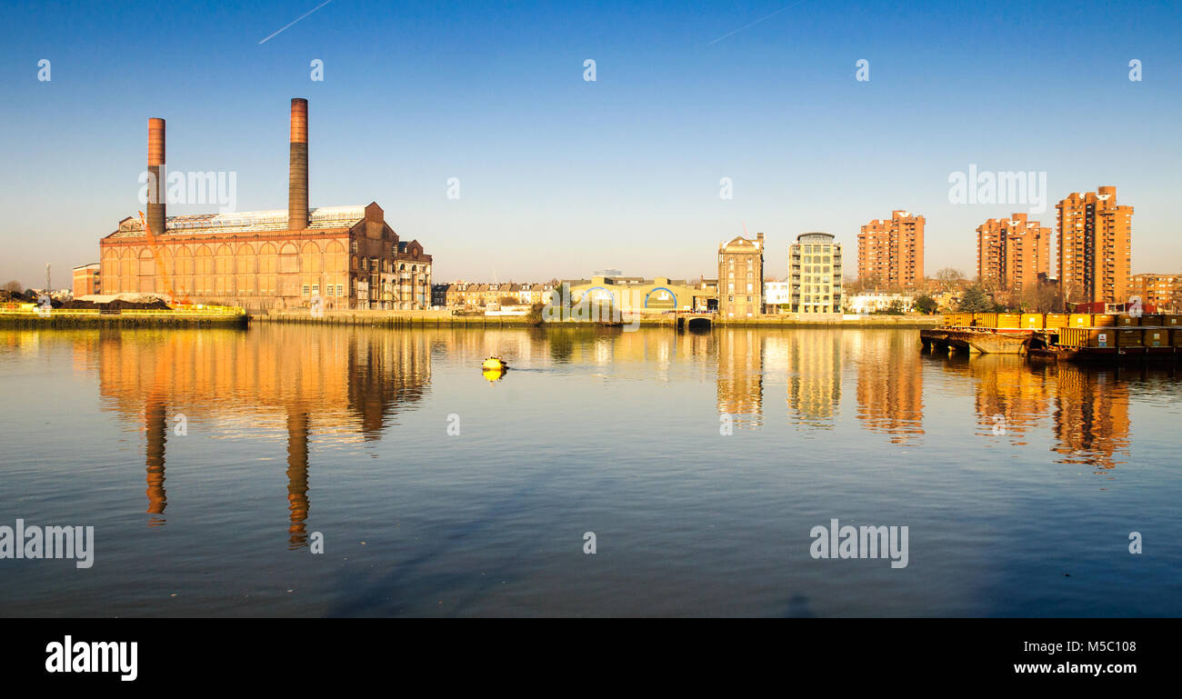 Lots Road Power Station and the World's End high-rise council estate are reflected in the waters of the River - Stock Image