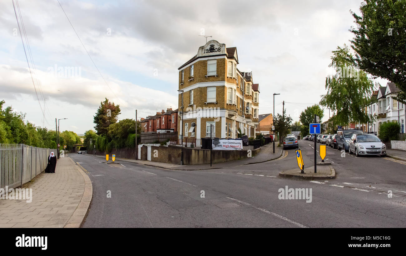 London, England - July 10, 2016: Terraced houses of Wells House Road in Old Oak Common, west London, are adorned - Stock Image