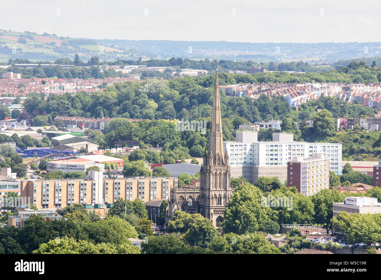 Bristol, England, UK - July 17, 2016: The tall spire of St Mary Redcliffe church and council housing blocks of the - Stock Image