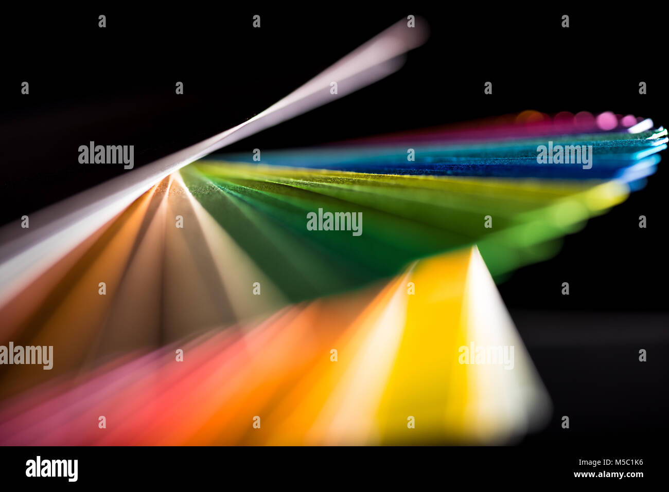 dynamic composition of colorful papers - Stock Image