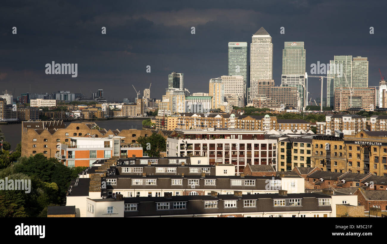 London, England, UK - August 5, 2016: Skyscrapers of London's Docklands financial district are illuminated against - Stock Image