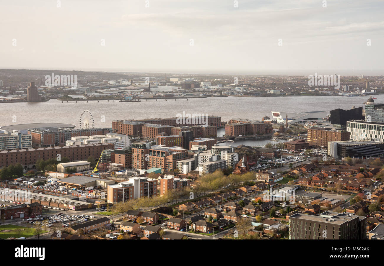 Liverpool, England, UK - November 9, 2017:  Warehouses of Liverpool's historic Albert Dock line the River Mersey - Stock Image