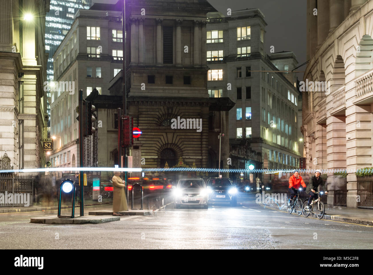 London, England, UK - January 11, 2018: Traffic waits at signals at Bank junction in the city of London, with St - Stock Image