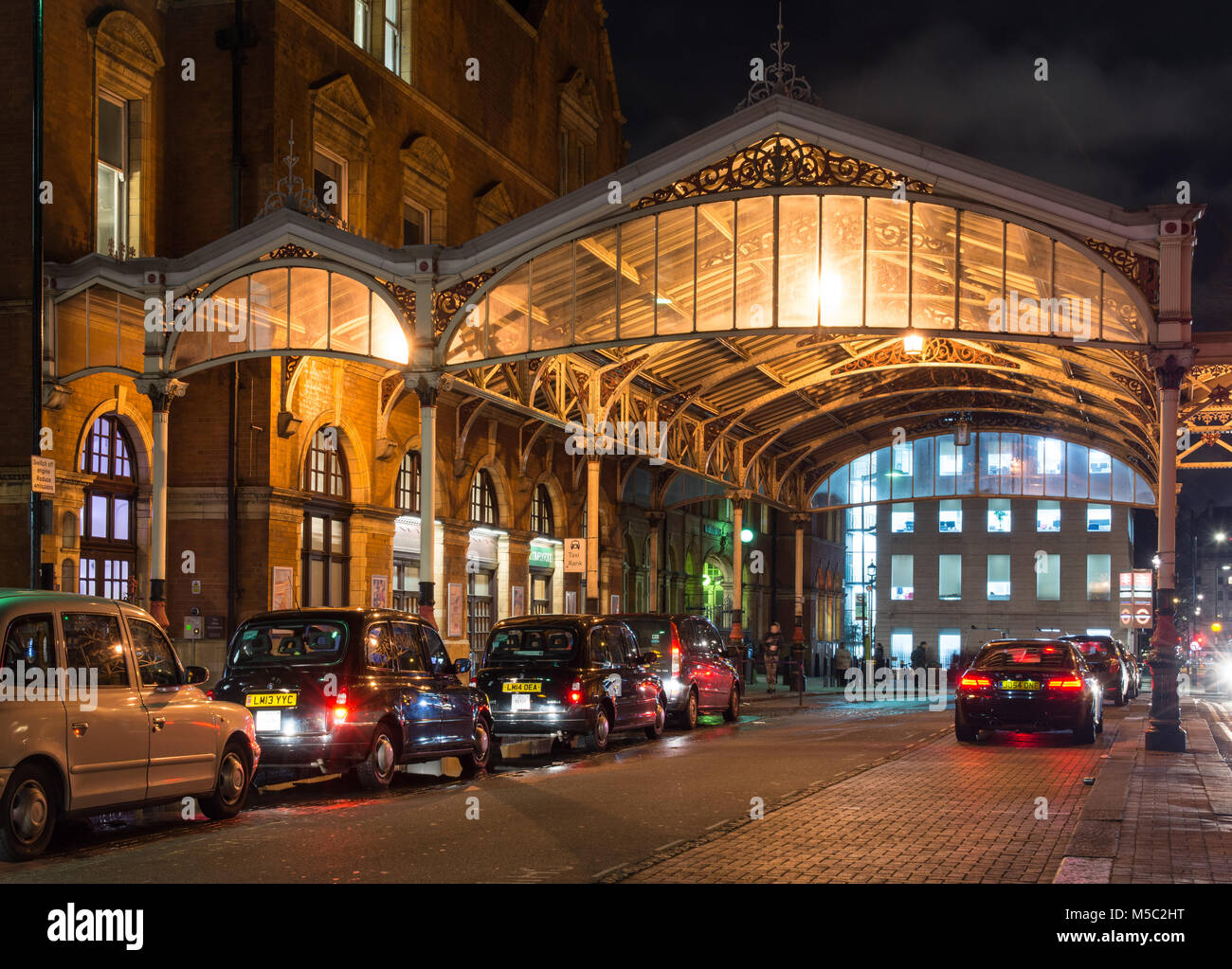 London, England, UK - January 16, 2018: Traditional London taxis queue to pick up commuters at Chiltern Railways' Stock Photo