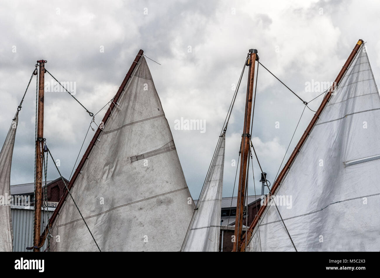mainsail of a sail ship docked in the harbour - Stock Image