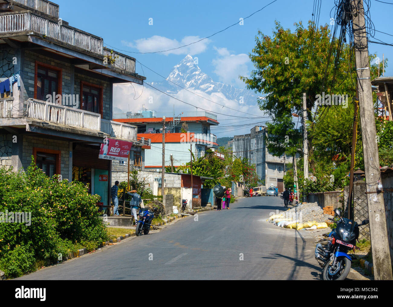 POKHARA, NEPAL - CIRCA NOVEMBER 2017: A street with the Machapuchare in the background. - Stock Image
