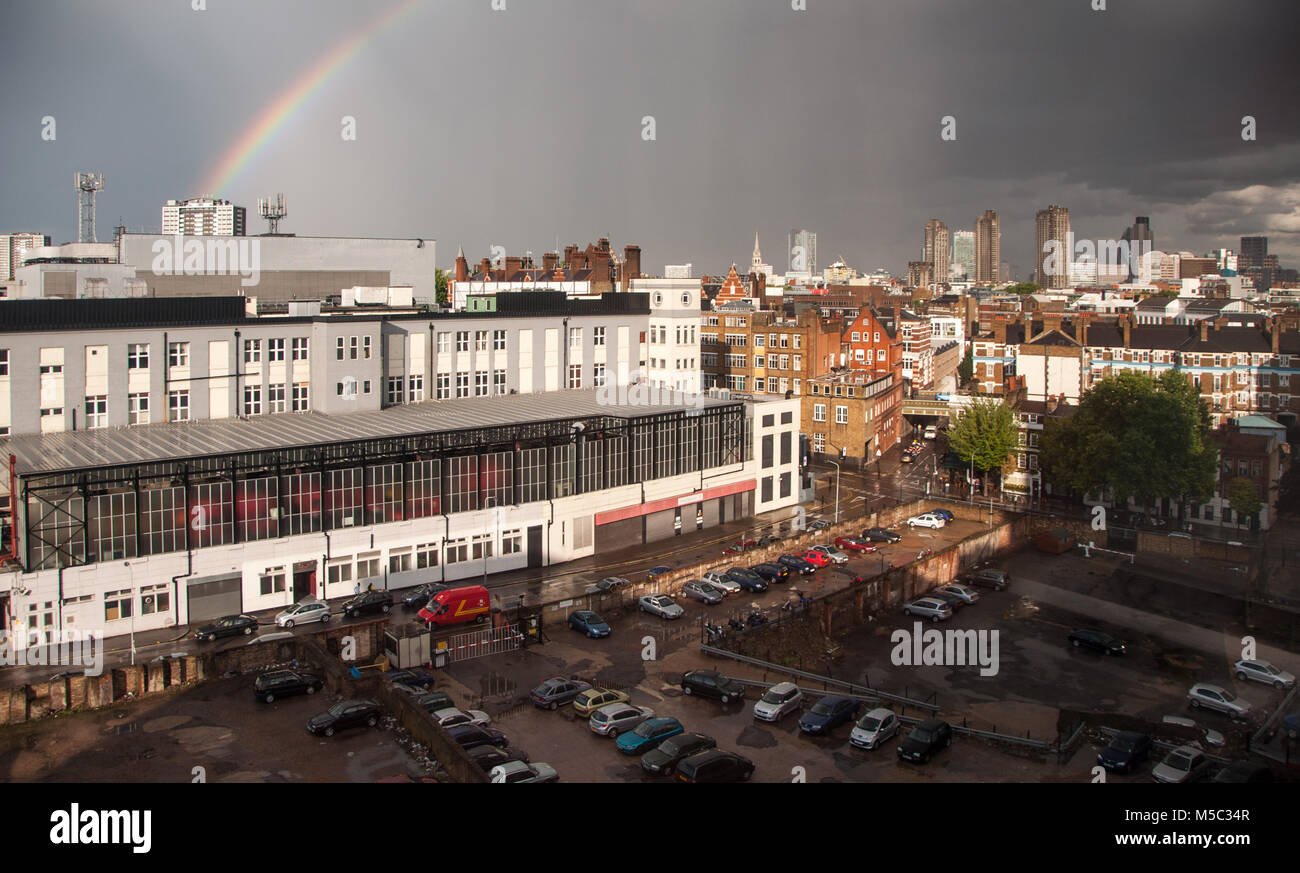London, England, UK - July 24, 2009: Sunshine creates a rainbow over Mount Pleasant Sorting Office, with the skyline - Stock Image