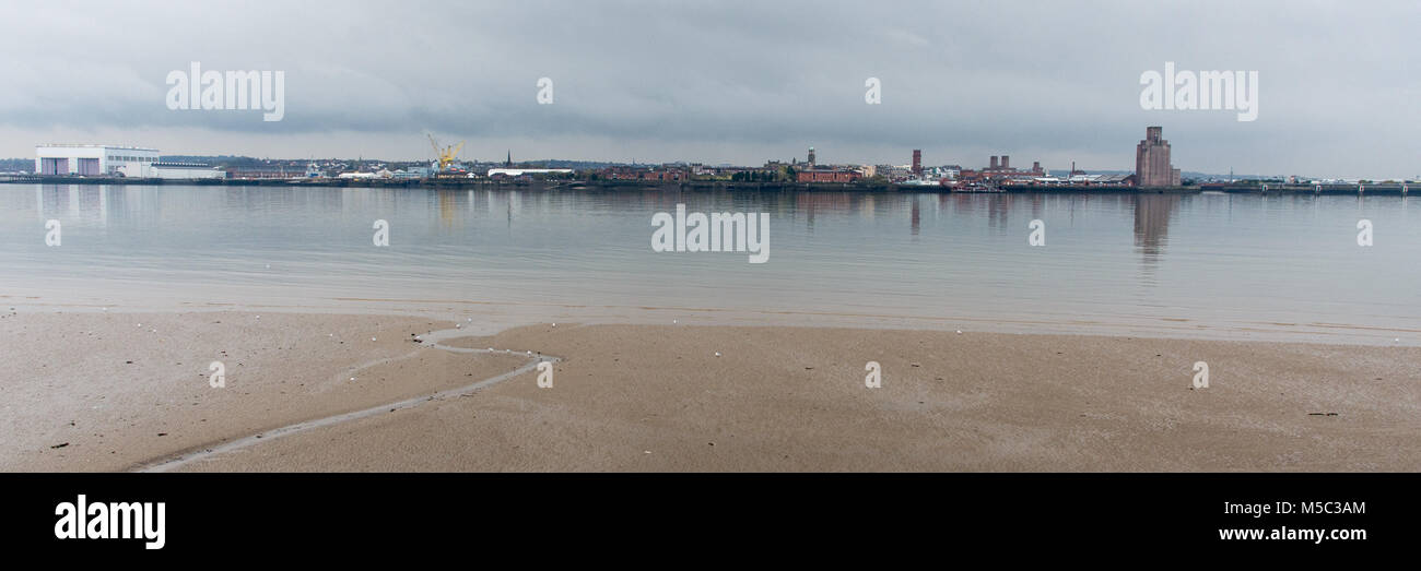 The riverfront and skyline of Birkenhead, including the Birkenhead Tunnel ventilation shaft and the docks hydraulics - Stock Image