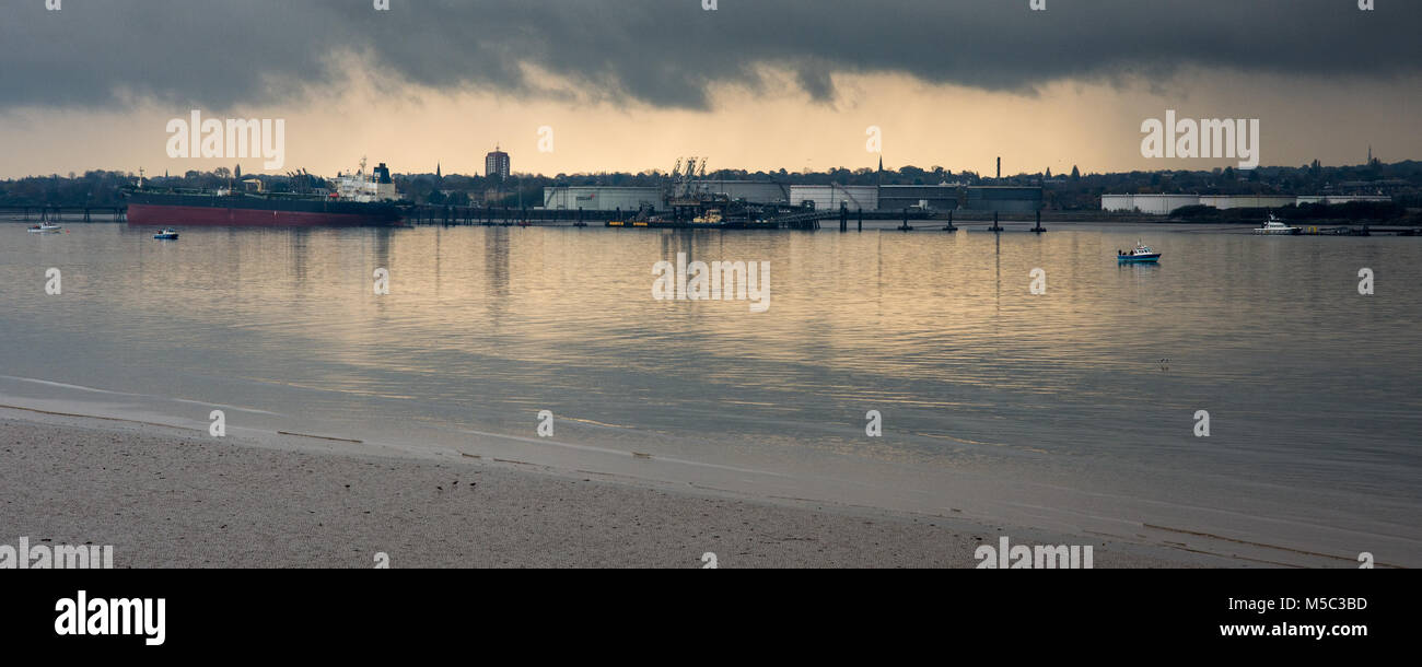The industrial waterfront of Birkenhead on the River Mersey viewed from Liverpool. - Stock Image