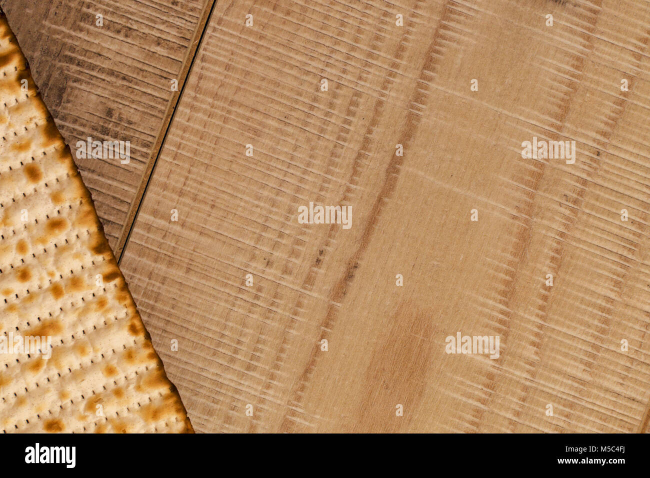 Passover Diagonal background. Jewish traditional Matzah top view on rustic wooden background with copy-space. Israel - Stock Image