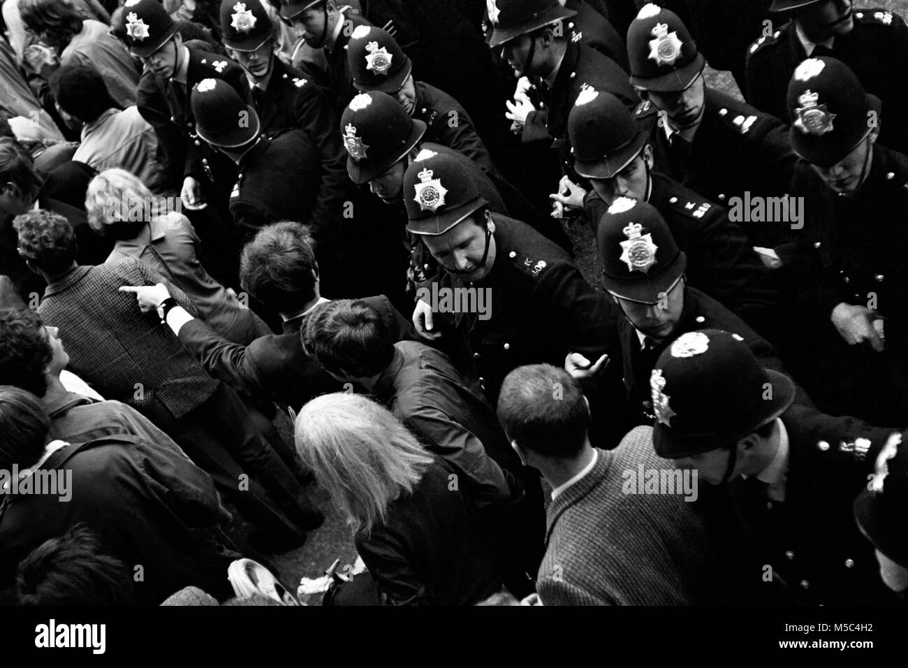 Anti-Vietnam war protest in London on 21 July 1968:  Demonstrators confront police near the American Embassy inStock Photo
