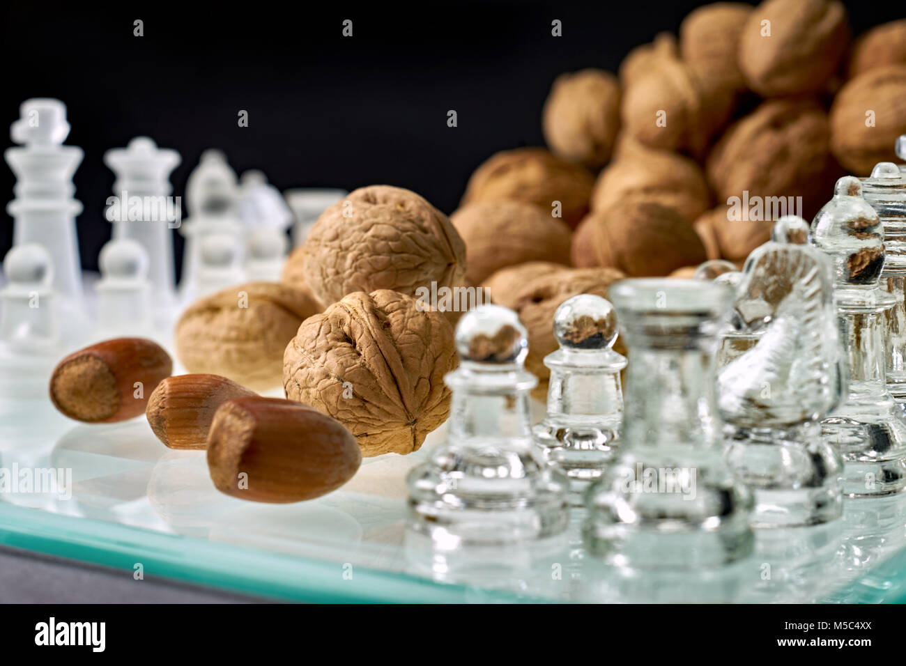 Nuts improve brain efficiency (visualization) - chess, chessboard with nuts - Stock Image