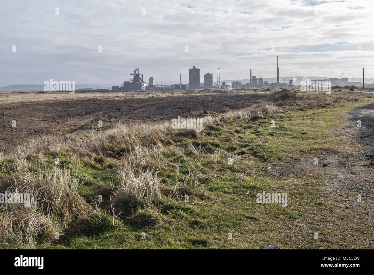 South Gare,Redcar with the former SSI steelworks in the background - Stock Image