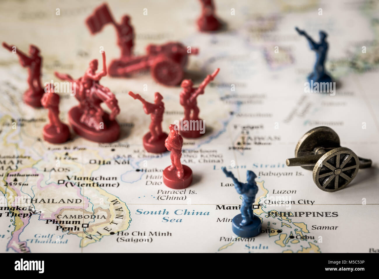 Macro close up of toy soldiers on a map representing conflict and tensions in the South China Sea Stock Photo