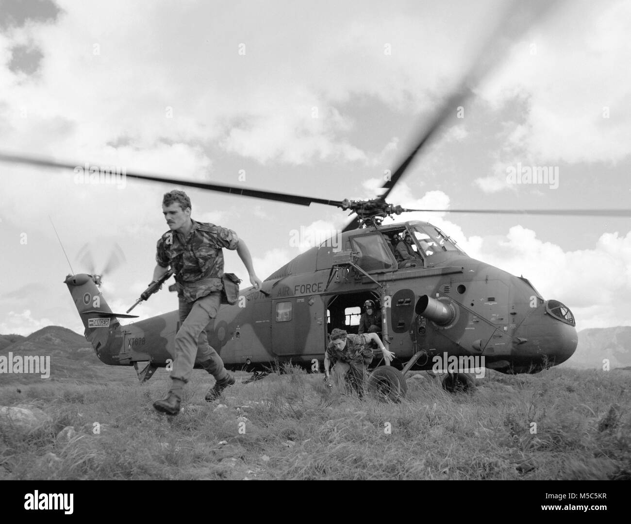 Soldiers exiting a RAF Westland Wessex helicopter on Lantau Island , Hong Kong. Stock Photo
