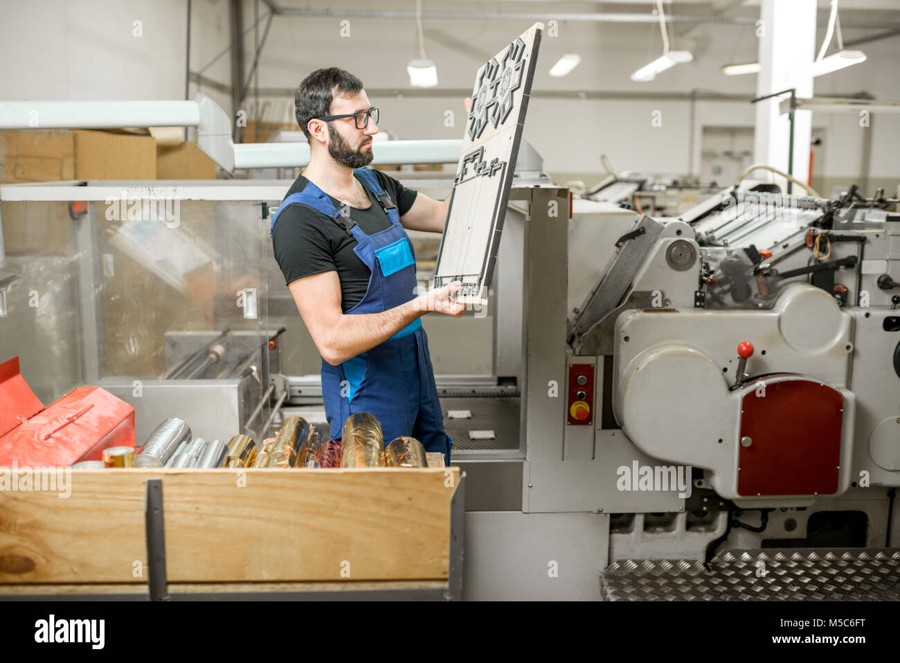 Workwe with cliche at the manufacturing - Stock Image
