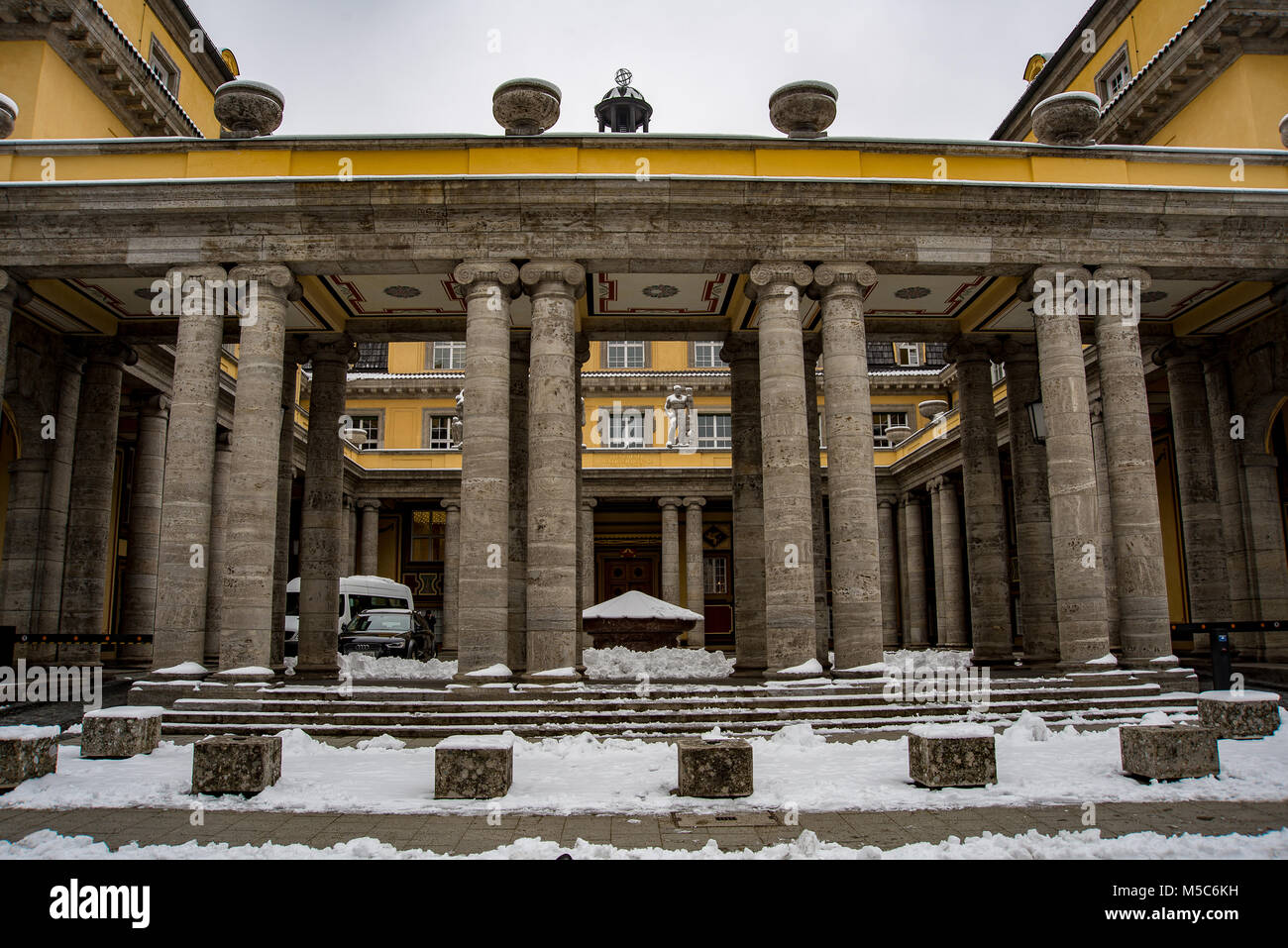 Snow covered exterior of the Munich Reinsurance Company headquarters. - Stock Image