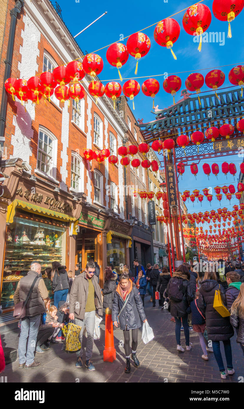 Colourful lanterns and a throng of people in Gerrard Street, Chinatown, to celebrate Chinese New Year. Westminster, - Stock Image