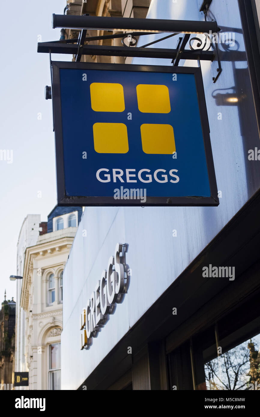 Greggs fast food store on Grainger Street, Newcastle upon Tyne, UK showing sign, logo. The largest bakery chain - Stock Image