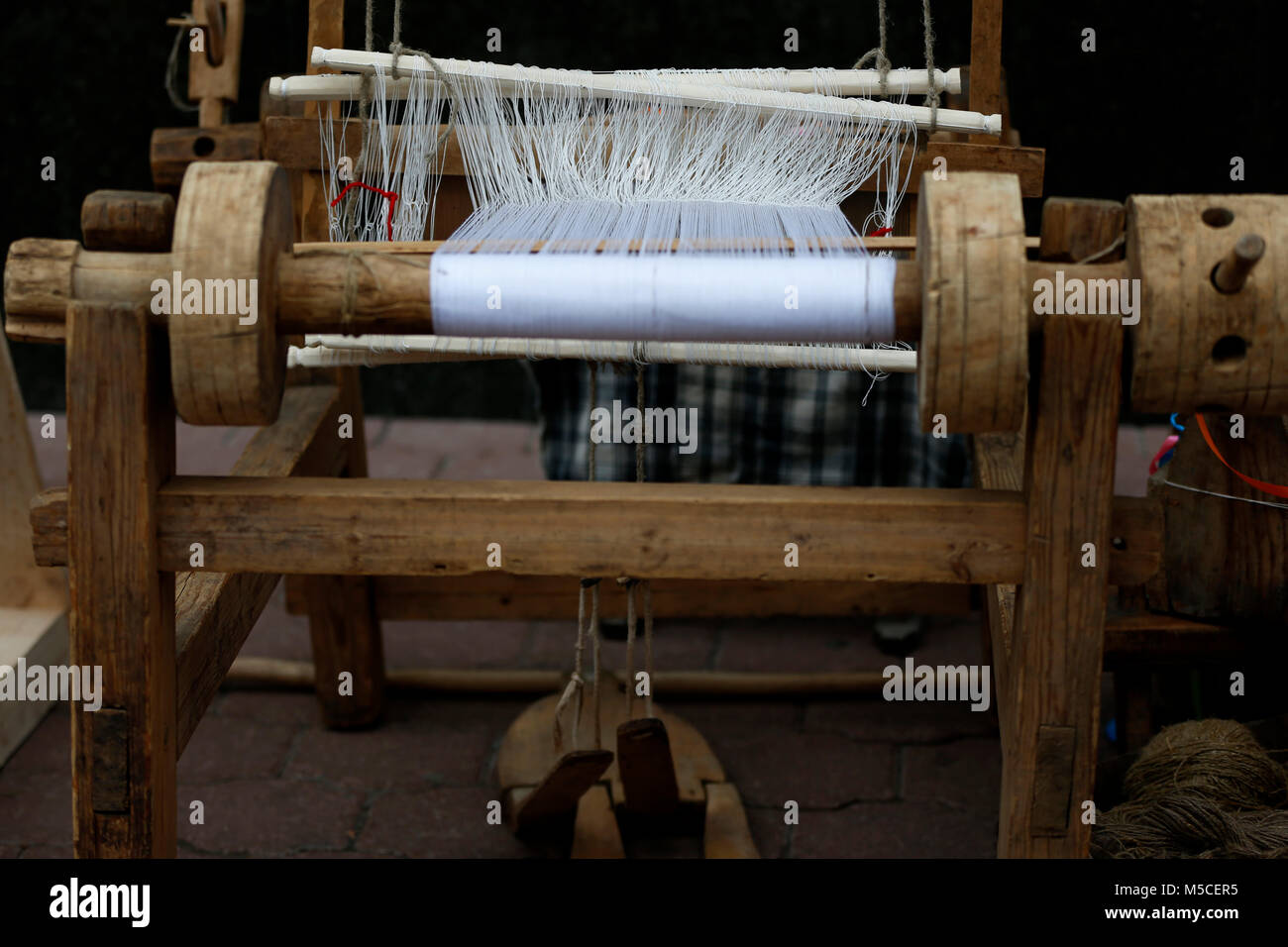 Belarus, Gomel, May 9, 2017, the Victory Day celebration,Ancient spinning machine.An ancient way to fabricate.Loom Stock Photo