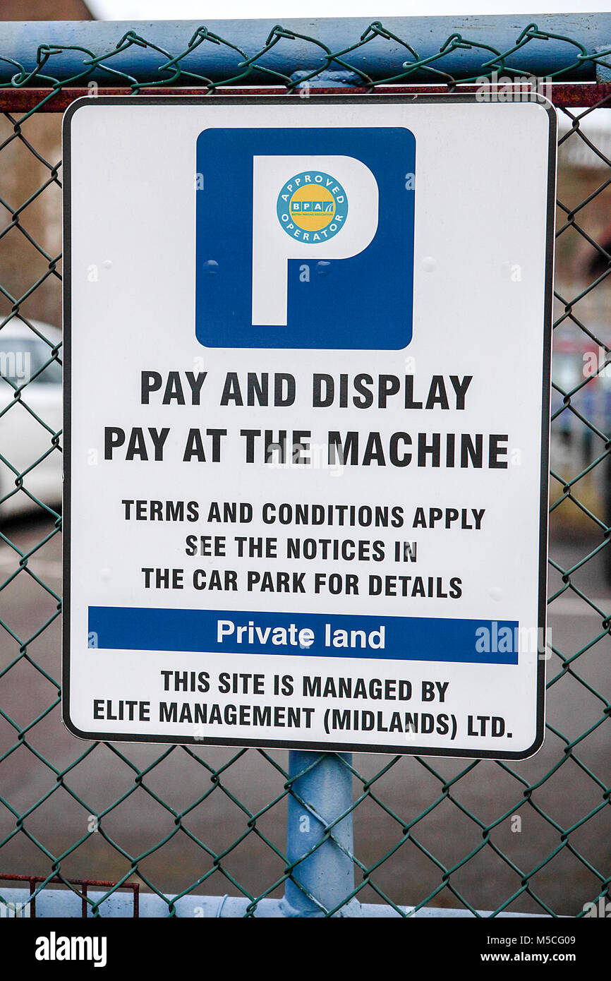 Park and display warning signs. - Stock Image