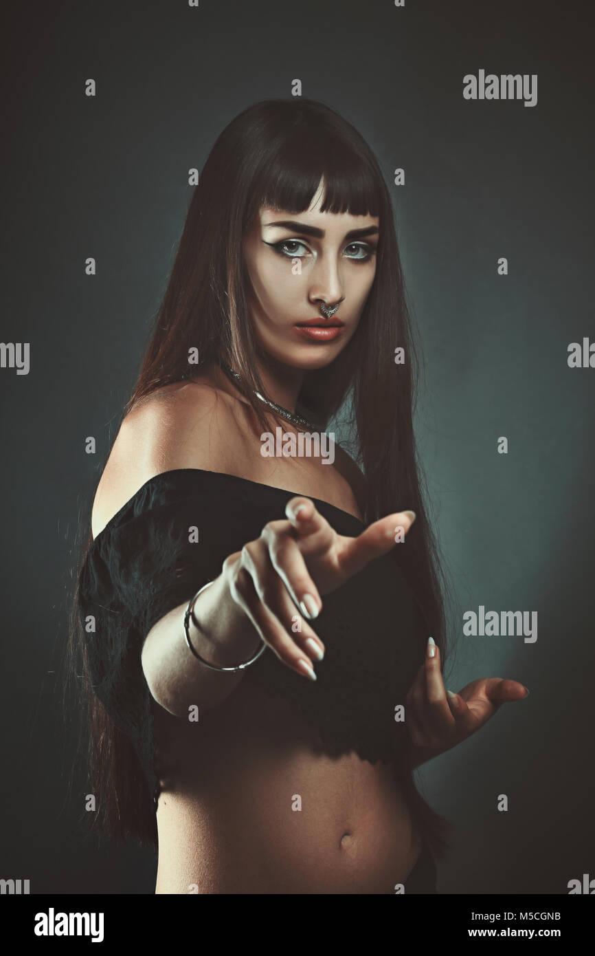 Dark beautiful gypsy. The witch portrait - Stock Image
