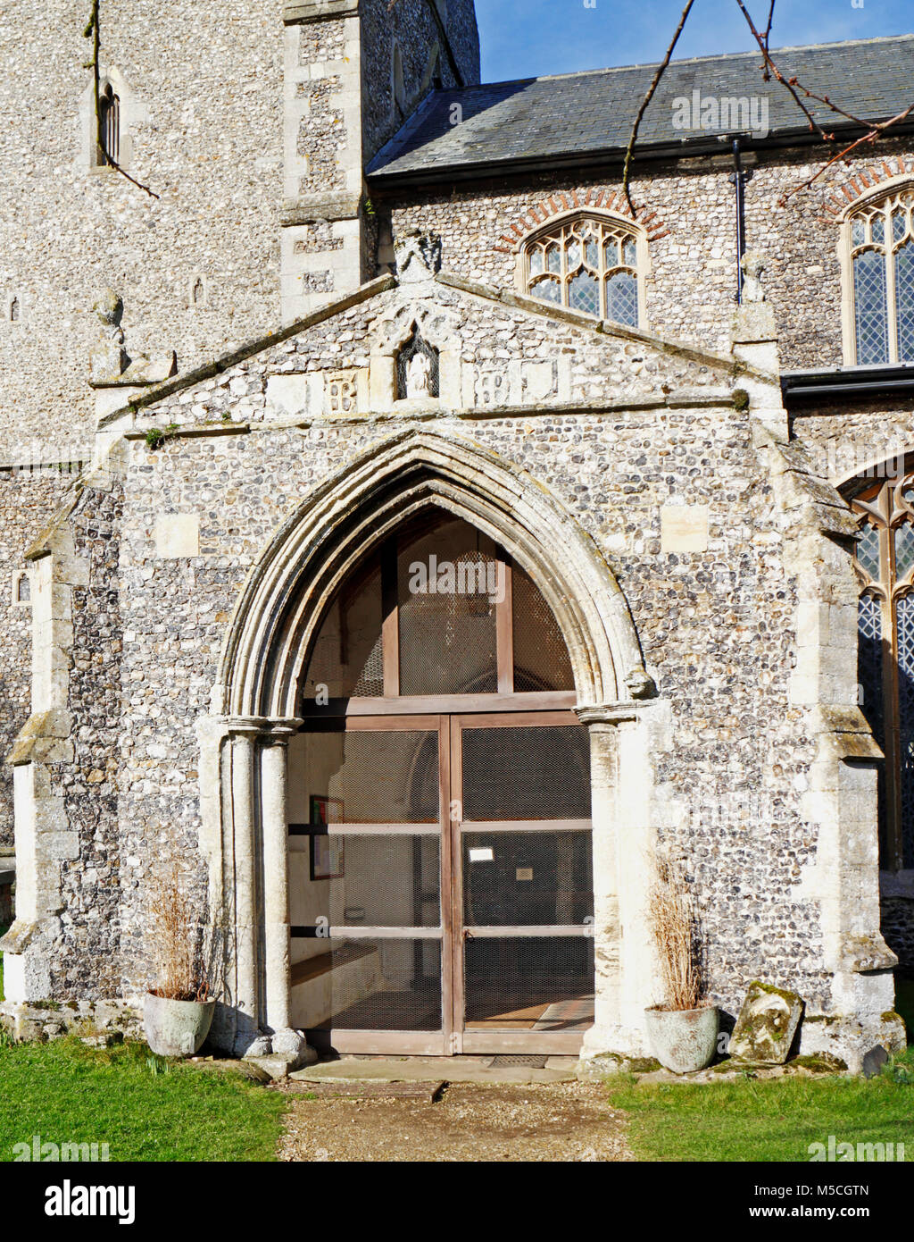 A view of the South Porch of the Church of Our Lady St Mary at South Creake, Norfolk, England, United Kingdom, Europe. - Stock Image