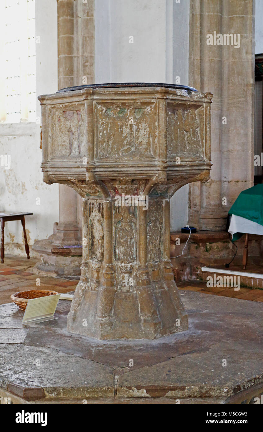 A view of the font in the parish church of Our Lady St Mary at South Creake, Norfolk, England, United Kingdom, Europe. - Stock Image