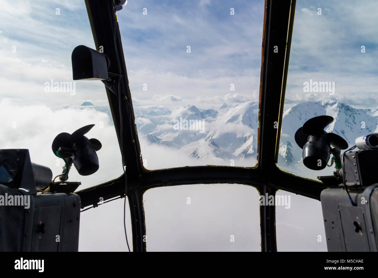 Aerial view through the helicopter window over the Central Tian Shan Mountain range, Border of Kyrgyzstan and China, - Stock Image