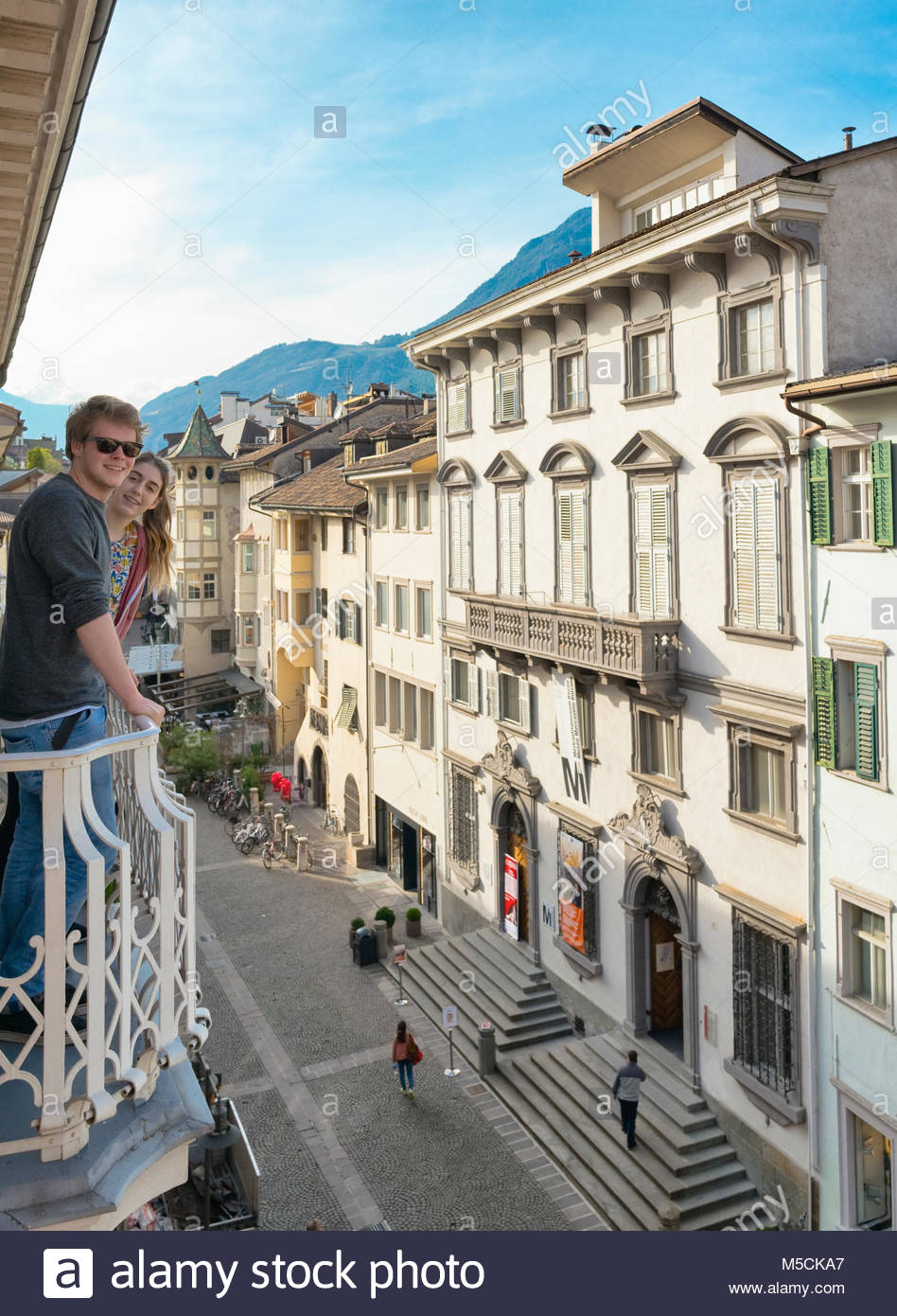 Young happy couple on holiday balcony Italy view - Stock Image