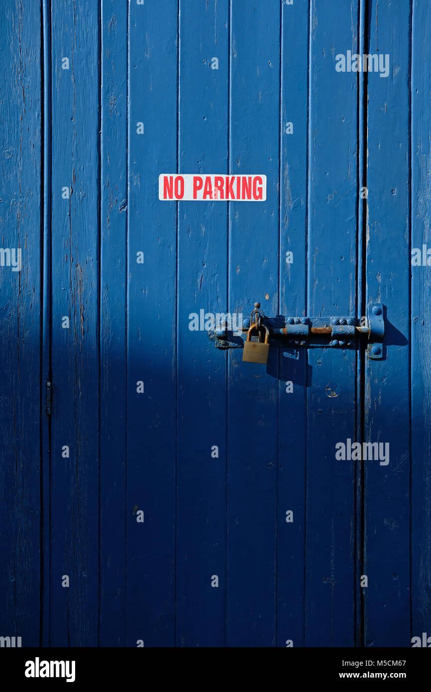No parking sign on door. - Stock Image