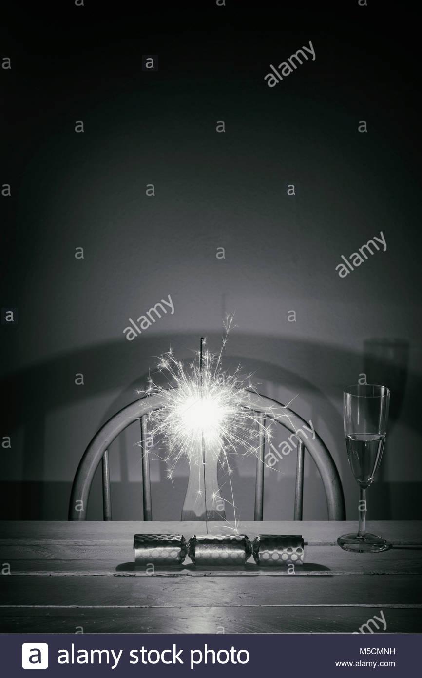 Christmas cracker Celebration sparkler wine glass Stock Photo