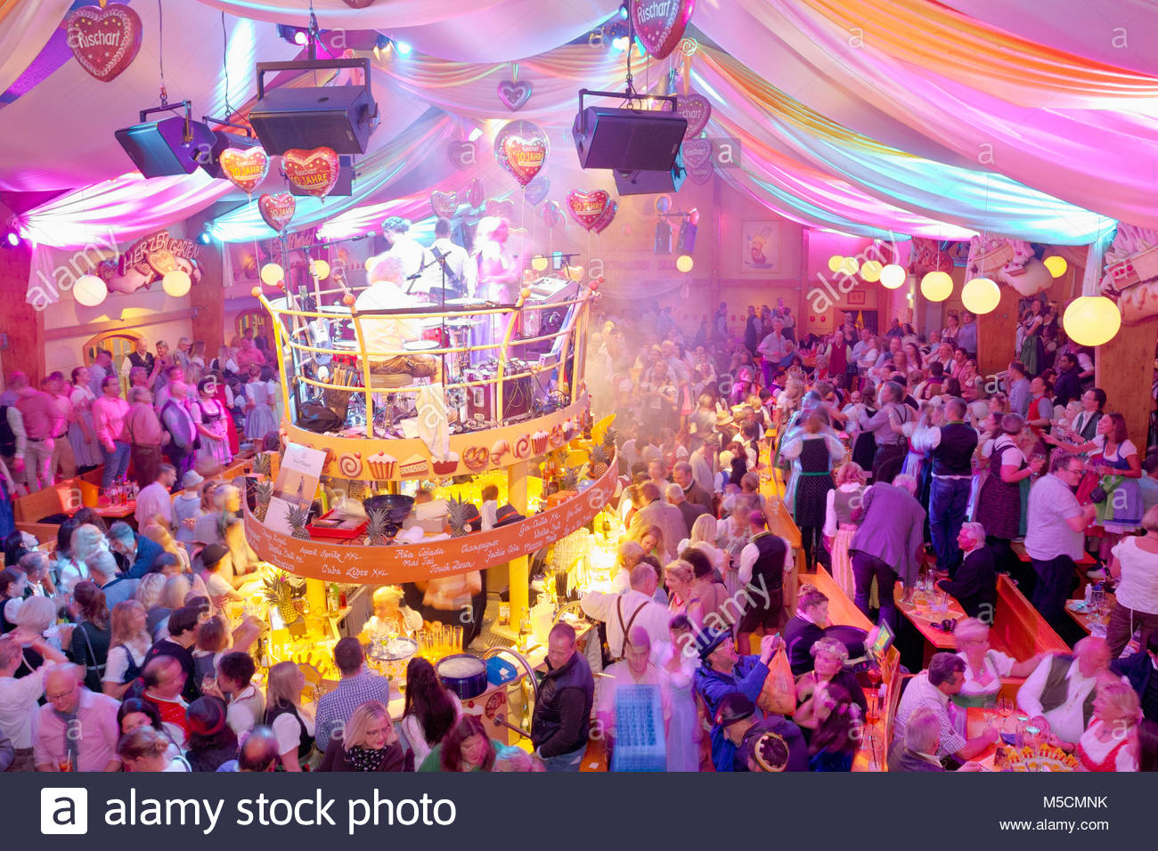 Oktoberfest beer wine tent party celebration crowd & Oktoberfest beer wine tent party celebration crowd Stock Photo ...