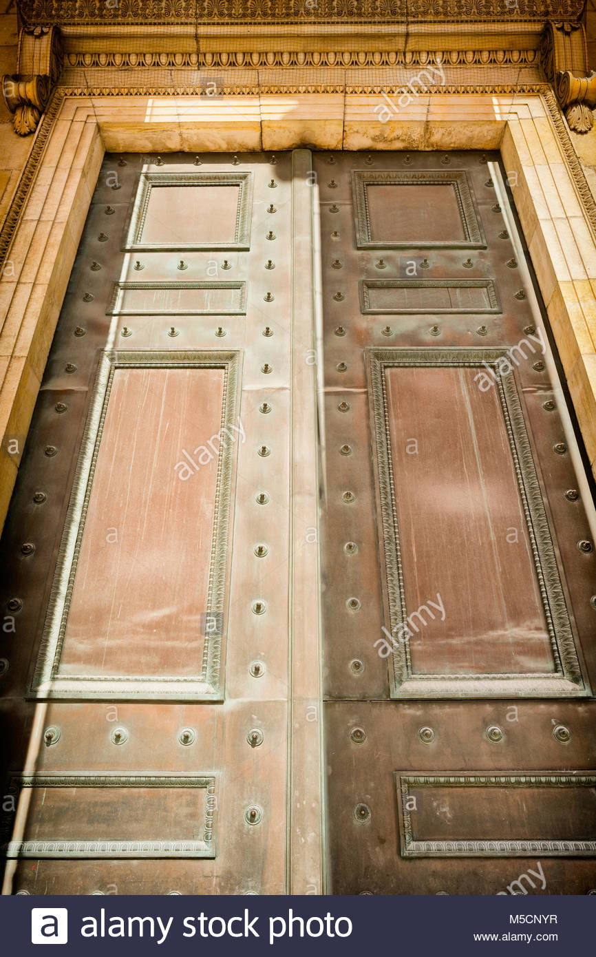 Large monumental bronze door entrance old ornate Stock Photo