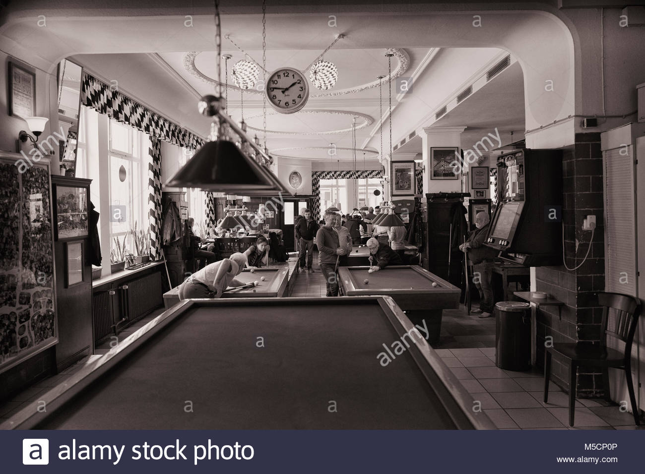 People playing pool in pool hall bar pub snooker - Stock Image