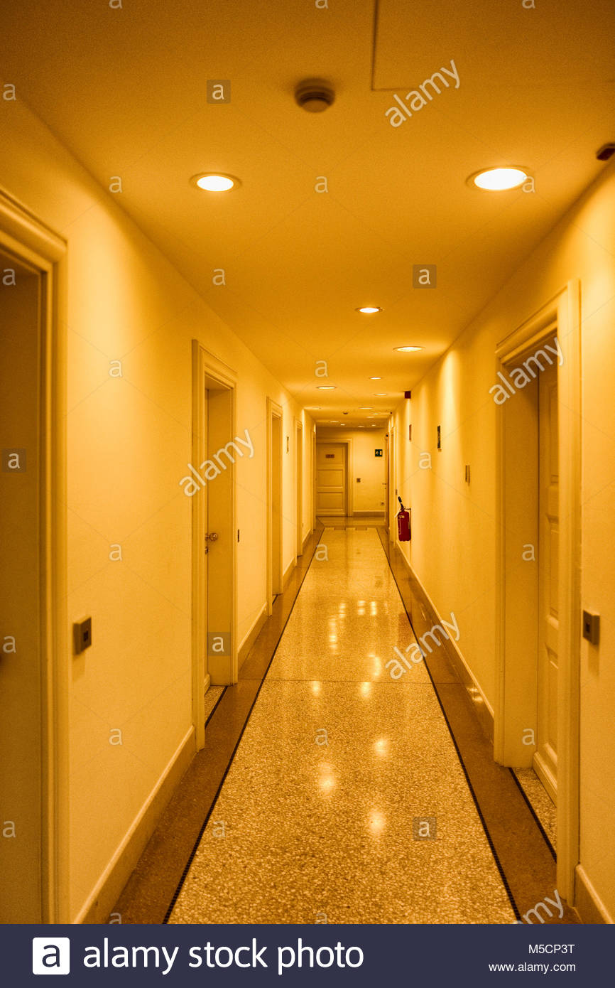 Long hotel corridor perspective vanishing point - Stock Image