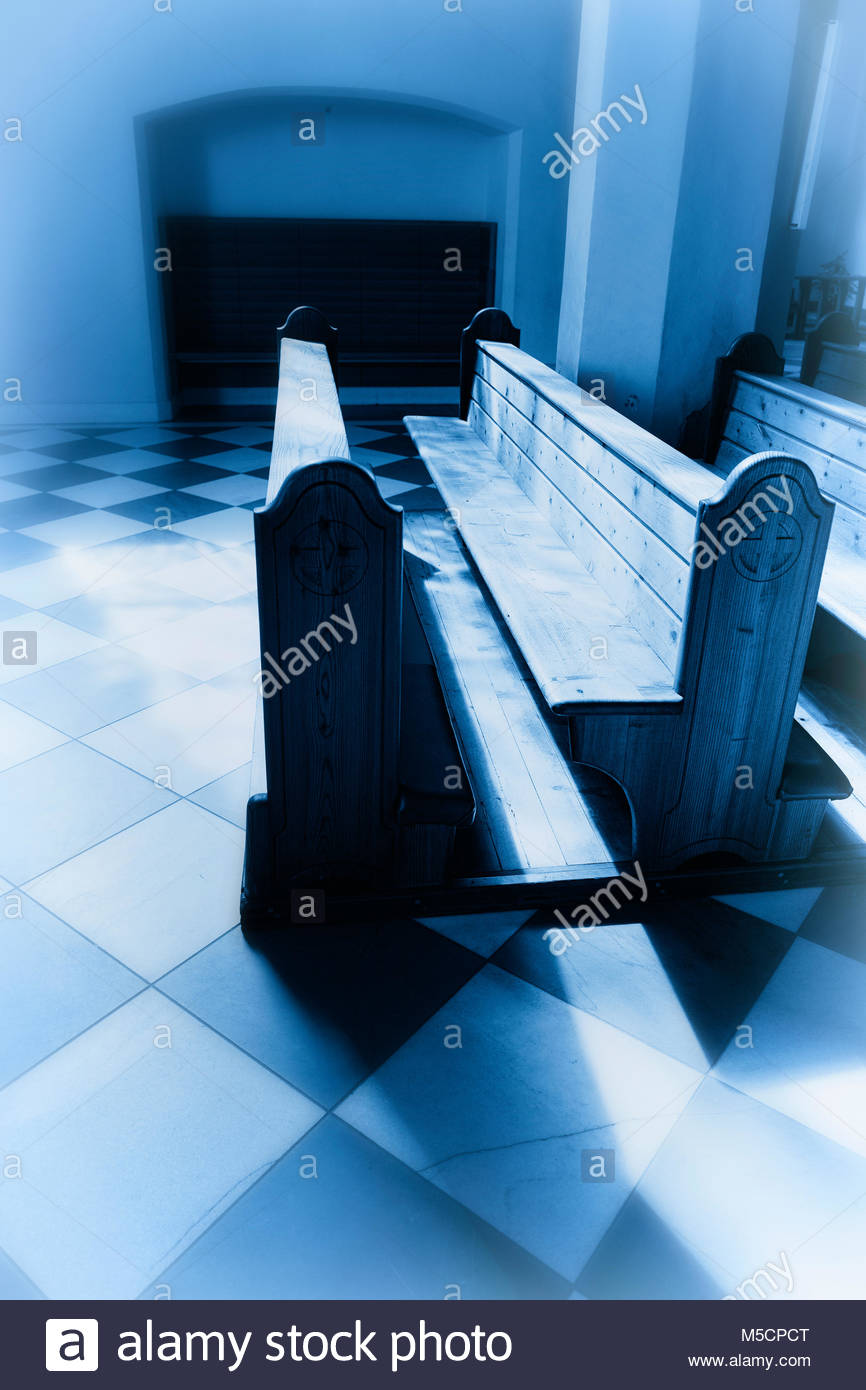 Interior church pew chapel blue toned sunlight - Stock Image