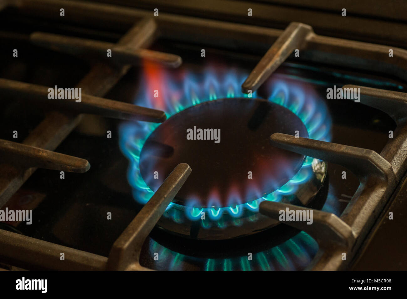 Gas flame on a range. - Stock Image