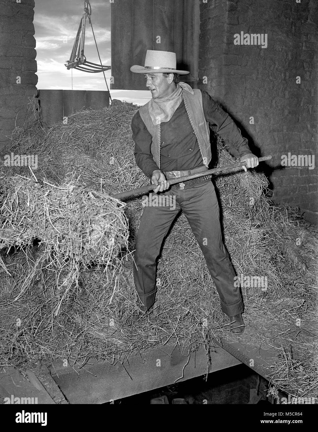 John Wayne in hayloft from the Movie Angel and the Badman. Image from original camera negative. - Stock Image