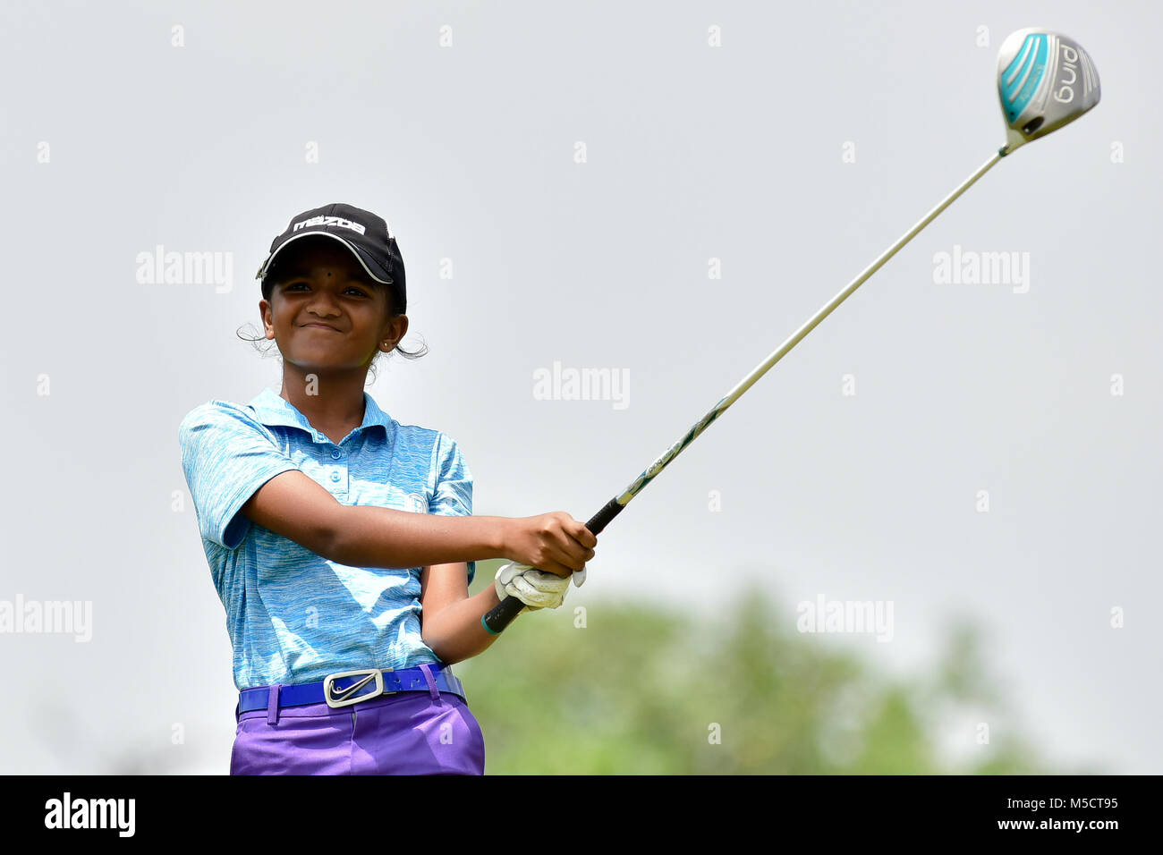 Danau, UKM Bangi - FEBRUARY 10: Divyasheni watches her tee shot on the 8th hole during Round One of the Danau Junior - Stock Image